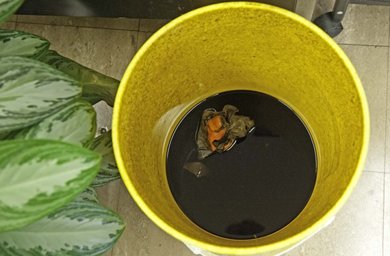 When leaks start, buckets such as the one above are used to catch black tar water. - SCOTT ELMQUIST