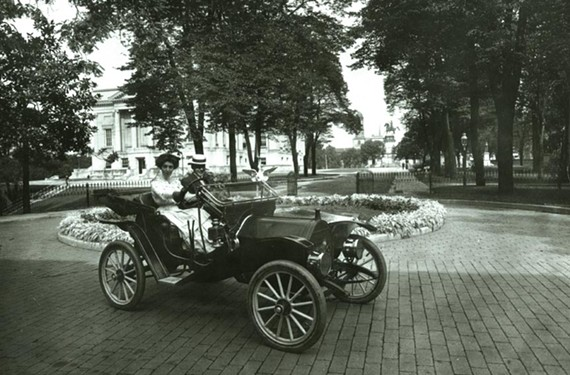 William Mann Jr., son of Gov. William Hodges Mann, lets a friend take the wheel of a Model T Ford in the mansion driveway (c. 1910). The Capitol, at left, and Washington Monument are in the distance. - LIBRARY OF VIRGINIA