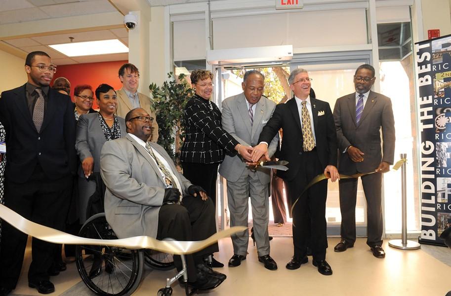 With scissors in hand, Mayor Dwight Jones helps open the city's Center for Workforce Innovation downtown in November. - SCOTT ELMQUIST