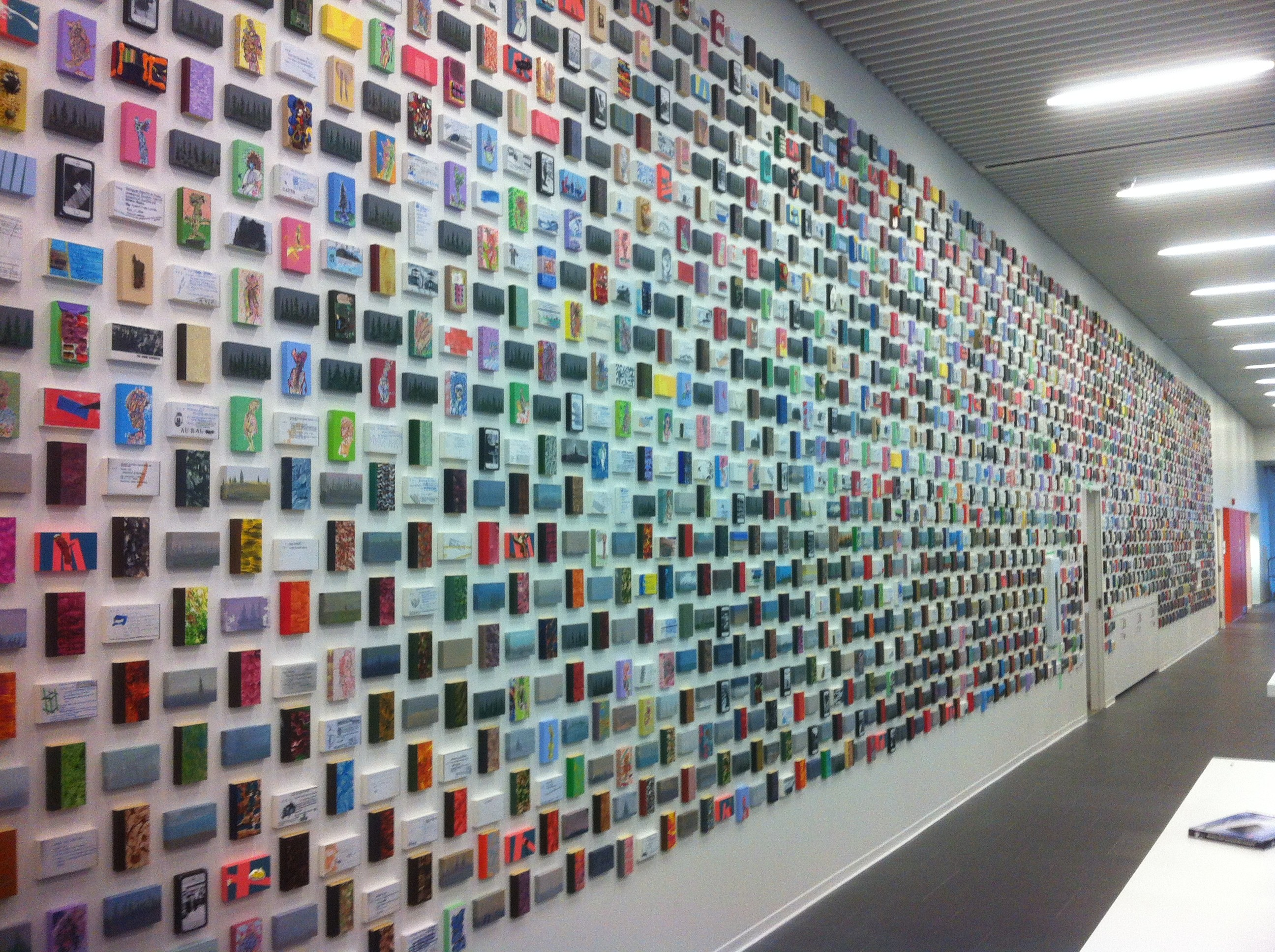 A wall of 5,000 miniature paintings in the main entryway.