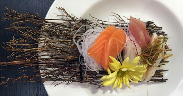 Butter fish, salmon and tuna make up this sashimi appetizer/work of art.