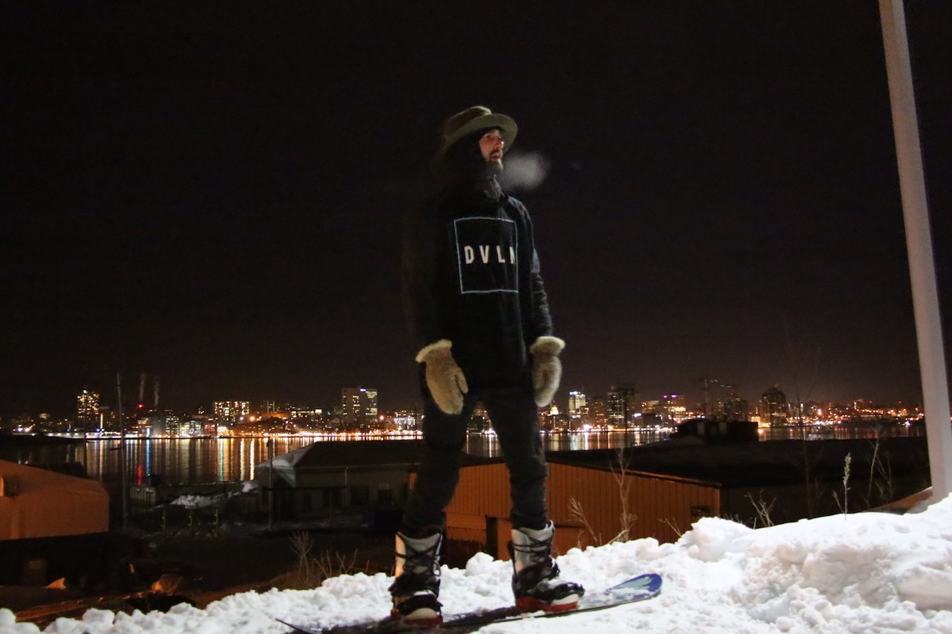 City Lights: Ian MacArthur sizes up the jib as he waits for a tow in. - AARON WILLIAMS
