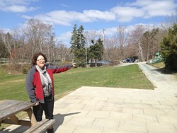 Commission volunteer Suzanne Roy shows off the site for the new cafe.