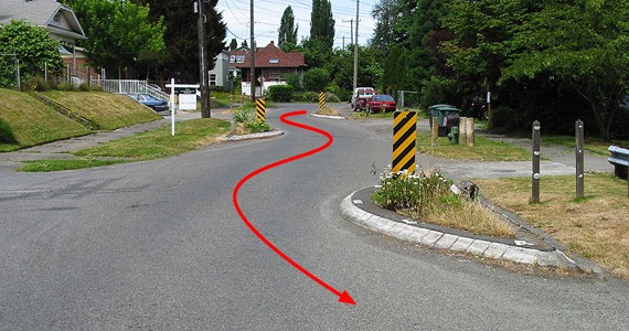Creating extra turns in a road, chicanes are built into some motor racing tracks and on some city streets to calm traffic by forcing drivers to slow down on the curves. - RICHARD DRDUL