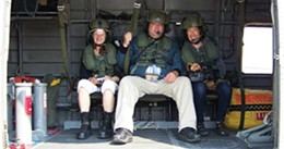 Director Ariella Pahlke (right) gets ready to go up in a Sea King helicopter to shoot ariel footage of Dartmouth with filmmaker Andrew Curran (middle) and Linda Rowe with the United Way's Action for Neighbourhood Change.