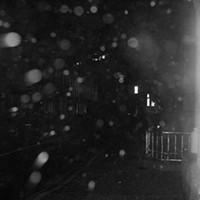 Facing the rain on Barrington Street.
