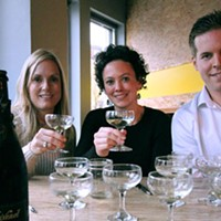 From left to right, Erin Horton, Heather Rankin and Jordan Dickie rasise a glass to (and of) sparkling wine.