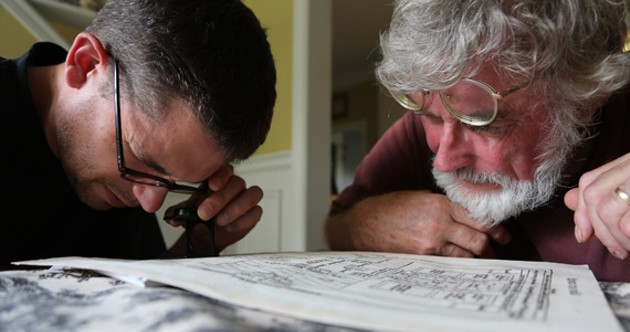 Gaspereau's Andrew Steeves and poet Peter Sanger examining an old manuscript page. - THADDEUS HOLOWNIA