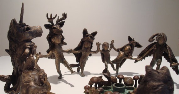 Goody-B Wiseman's work features small bronze statues of children - with interesting animal masks.