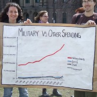 Heidi Verheul and Rob White with sign showing federal spending