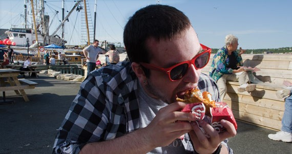 He's eating fish wrapped in a BeaverTail. - COURTNEY KELSEY