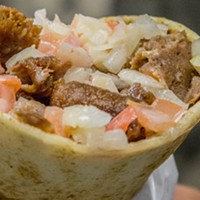 In Alberta this donair would be packed full of lettuce and an assortment of sauce options.
