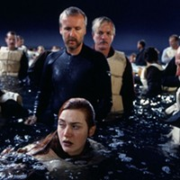 James Cameron and Kate Winslet in shallow waters on the Titanic set.
