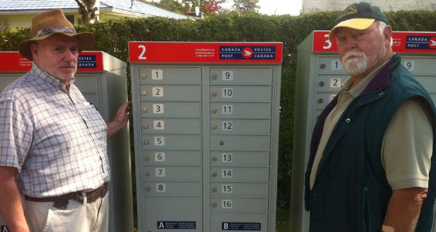 Jim Matthews and Barrie Ross in front of their future community mailbox.