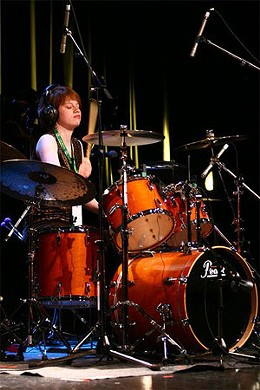 Katie Patterson, drummer extraordinaire, fused to her drum kit.