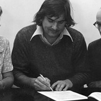 Lib Connor, secretary of the NSCAD board, president Garry Neill Kennedy and board chair Darrell Mills signing the lease for the downtown campus in 1976.