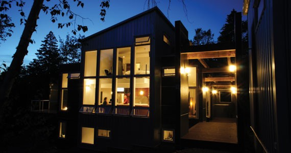 Lots of glass makes the Macleans' home glow at night