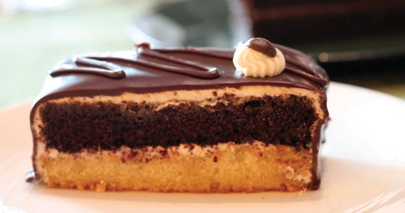 Monsoon Cafe's namesake cake piles chocolate and vanilla layers inside an icing shell. - MELISSA BUOTE