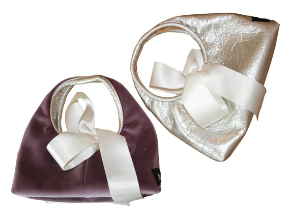 MORE PERSONAL BAGGAGE Turbine reversible hobo-bags, $42, Turbine Boutique, 1475 Lower Water, 429-0986.