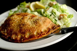 Rogue's calzone is a poor mockery of delicious. Stick to the beer. photo Julé Malet-Veale