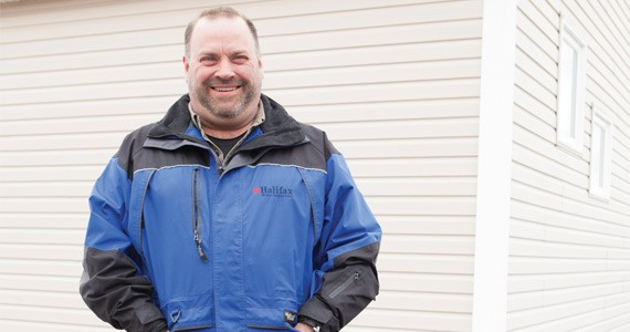 Roof trouble? Darren Smith's on top of it. - RILEY SMITH