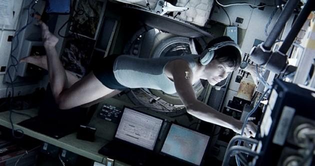 Sandra Bullock in Gravity, having a space ball.