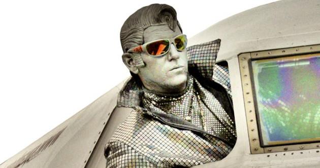 Silver Elvis flying to the Halifax International - Busker Festival