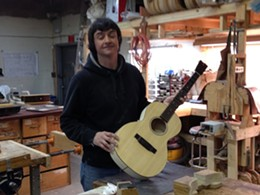 Stu shows off the guitar he built.