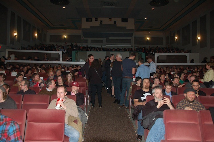 The crowd, ready for blood! Including the silver-haired gent, producer Niv Fichman