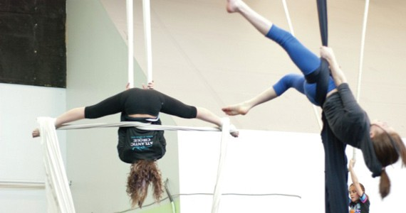 The daring young gals of the flying aerial silks.