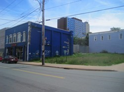 The Saint Leonard's Society will build a four-storey transitional housing complex on this empty lot on Gottingen Street, next to the Company House (left).