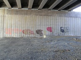 The un-completed underpass is the target of graffiti artists.
