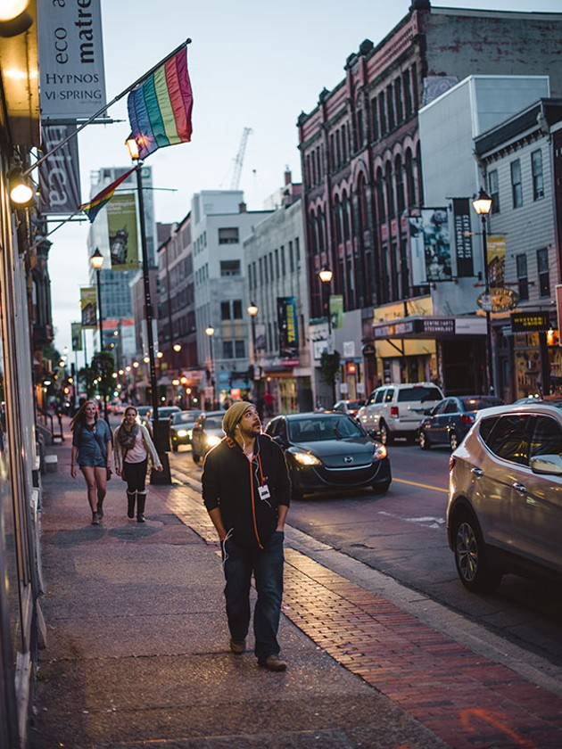 Halifax, Nova Scotia, 2014 Cory, an audience participant walks city streets listening to an audio guide. - MEL HATTIE