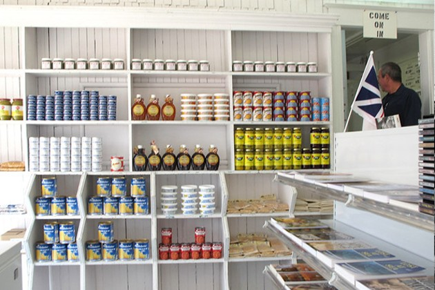 Stark white shelves line the walls inside the Newfoundland Store; they've carried essential household staples for over 50 years. - SHELAGH DUFFETT