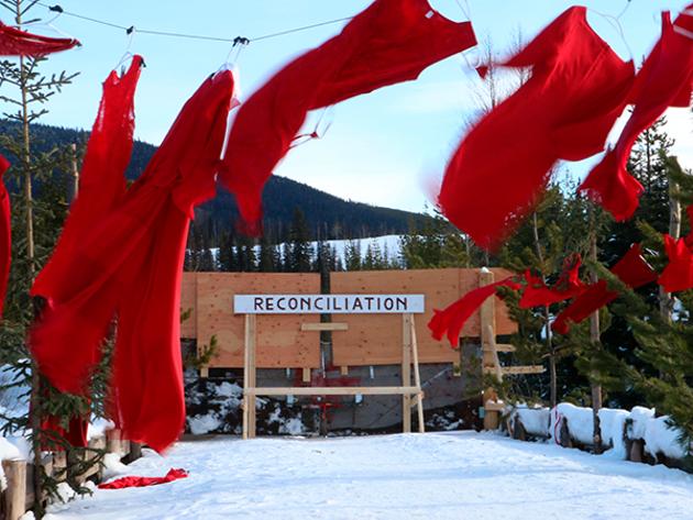 Red dresses hung along the road near the Unist'ot'en healing centre in BC. - AMANDA FOLLETT HOSGOOD