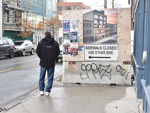 """Construction sites that interfere with sidewalks, like those along Gottingen Street, are now legally required to create barriers with the """"F-type"""" concrete chunks like the one here on Gottingen Street. - THE COAST"""