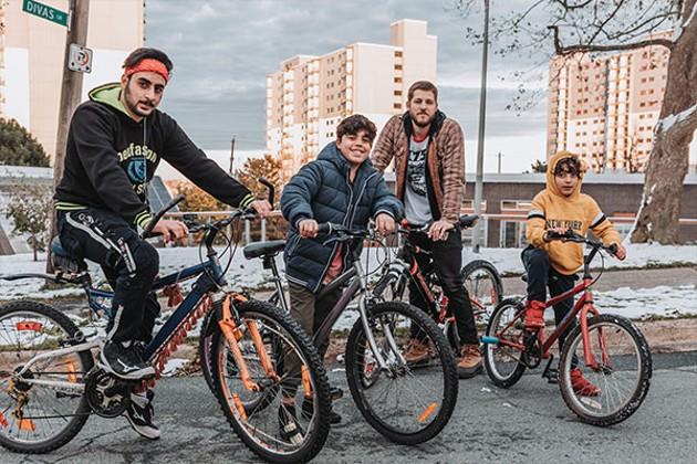 Left to right: Mohammad Aljenadi, Ahmad Elsalih, Sam Kamminga, and Muaz Elsalih on their fix-it-yourself bicycles. - JAMES MACLEAN