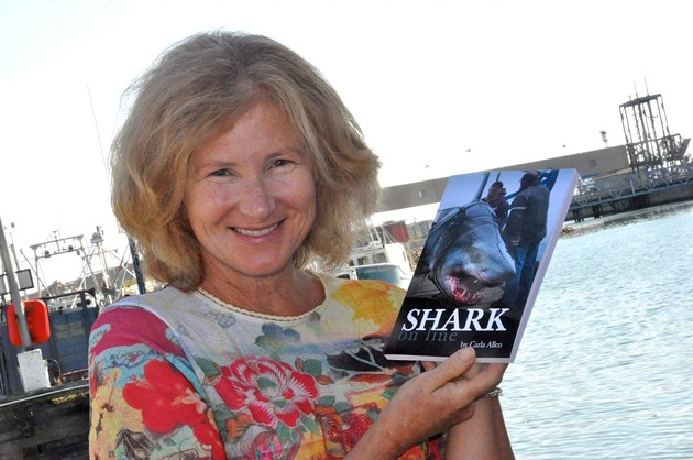 Carla Allen poses with her book in 2012. Buy Shark On Line here - PHOTO BY TINA COMEAU AND THE YARMOUTH VANGUARD