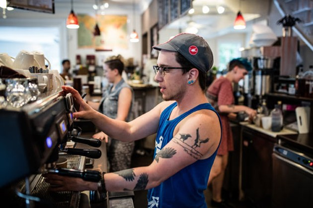 Barista Jude Kay pours a hot one. - RILEY SMITH