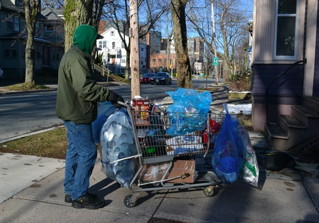 Greg, a regular recyclables collector, pushes his cart up Jubilee Road. - REBECCA DINGWELL