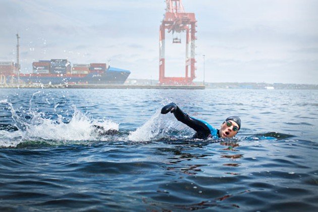 Writer Hillary Windsor braves the cold, mostly-clean waters of Halifax Harbour off of - Black Rock Beach. - LENNY MULLINS