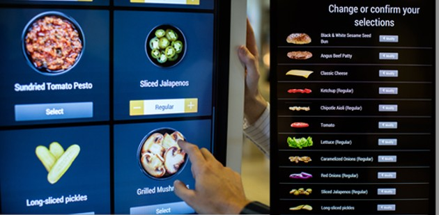 McDonald's has modernized the ordering experience with new touch-screen digital kiosks. - RILEY SMITH