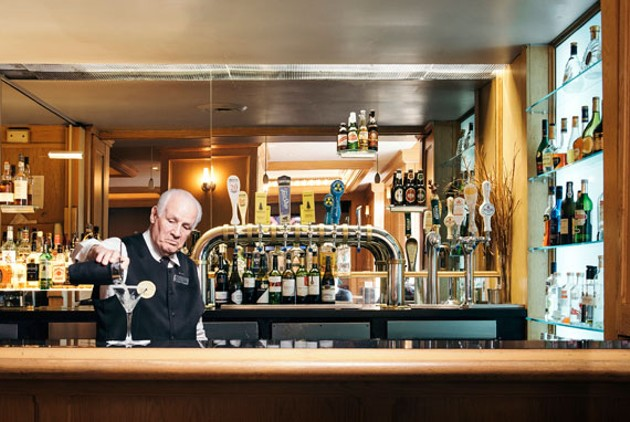 """To me it's not a job, it's a life,"" says Roy's Lounge's namesake, Roy Clorey. - NXN PHOTOGRAPHY"