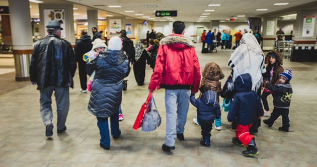 Syrian refugees arrive at the Halifax airport last winter. - SPIRO PAPPAS FOR ISANS