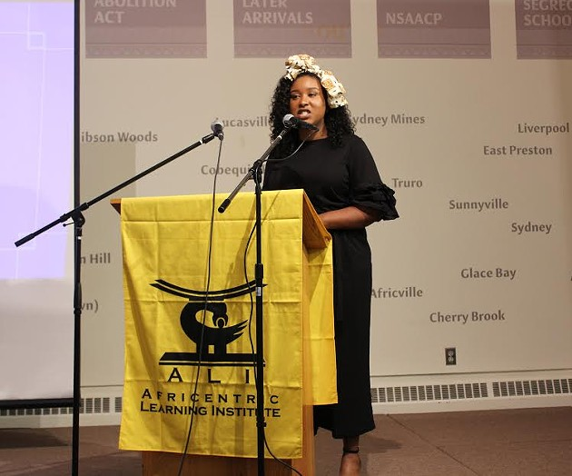 Project coordinator Nzingha Millar speaks at last week's screening. - SUBMITTED