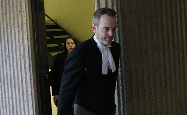 Riley's attorney, Trevor McGuigan, entering court. - KIERAN LEAVITT