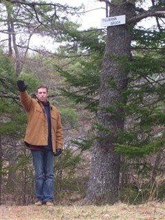 Tillmann makes a Nazi salute next to the Tillmann Brook sign. - TROY MEDIA