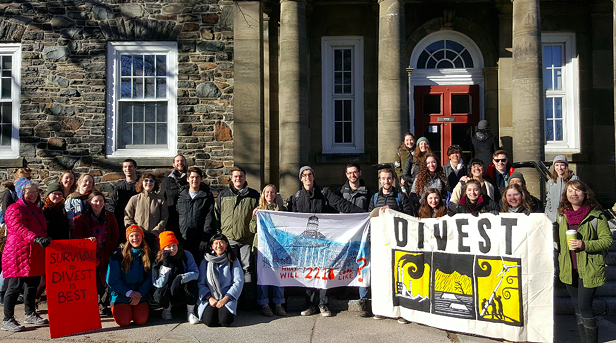 Activists celebrate last winter after the Dalhousie board of governors votes to look into divestment. - VIA DIVEST DAL