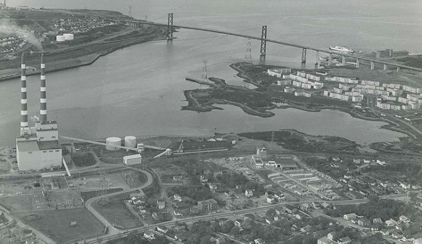 Tuft's Cove, Shannon Park and MacKay Bridge, circa 1973. The peninsula jutting out to the left of the military housing will be soon transferred to the Millbrook First Nation. - HALIFAX MUNICIPAL ARCHIVES