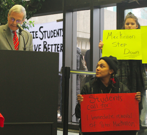 MacKinnon (left) speaking next to student protesters. - ASHLEY CORBETT